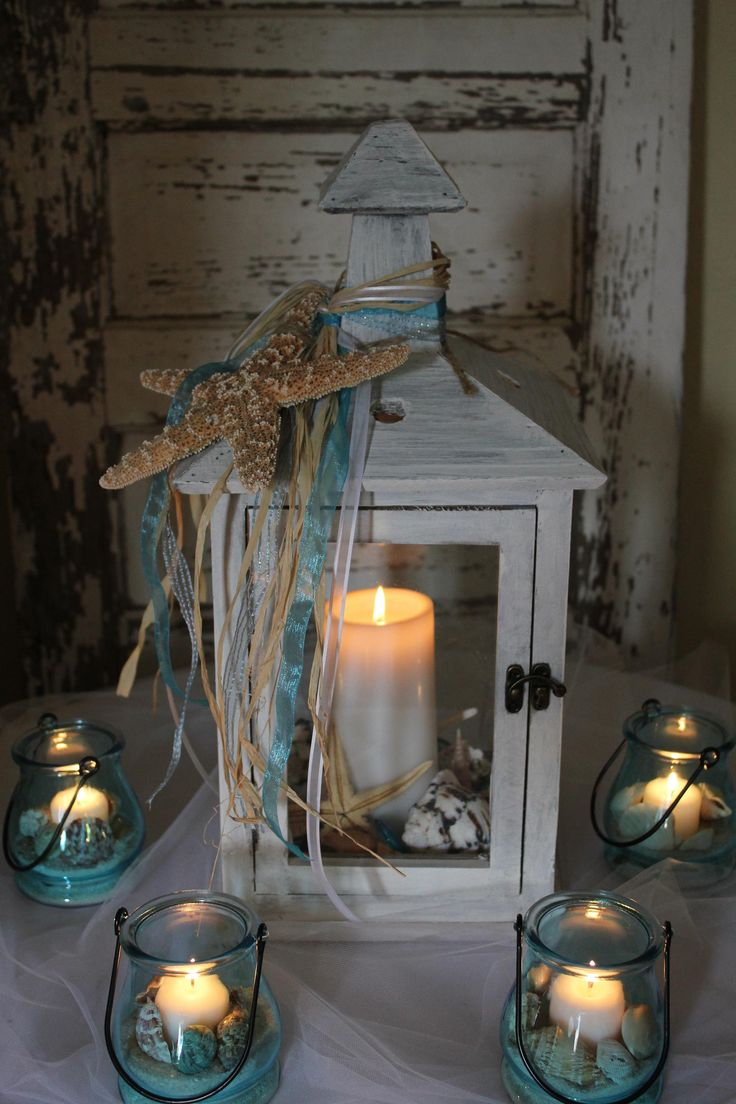 Love the seaside theme :) and what if all the centerpieces aren't the same, and we just do random 'structures' similar to this that we find at thrift stores, etc. throughout the year?