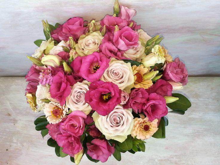 Pastel bouquet in wonderful colours: soft pink, dark pink, light orange. Magic combination of lisianthus and garden flowers.