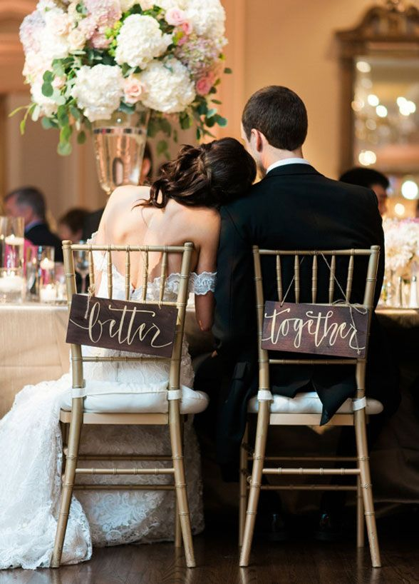 Wooden signs provide a sweet sentiment for this couple's special day. Wedding Decorations, Wedding Chairs, Bride and Groom Chairs || Colin Cowie Weddings
