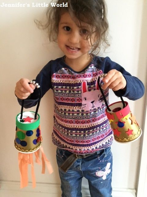 Child holding home made Chinese lanterns