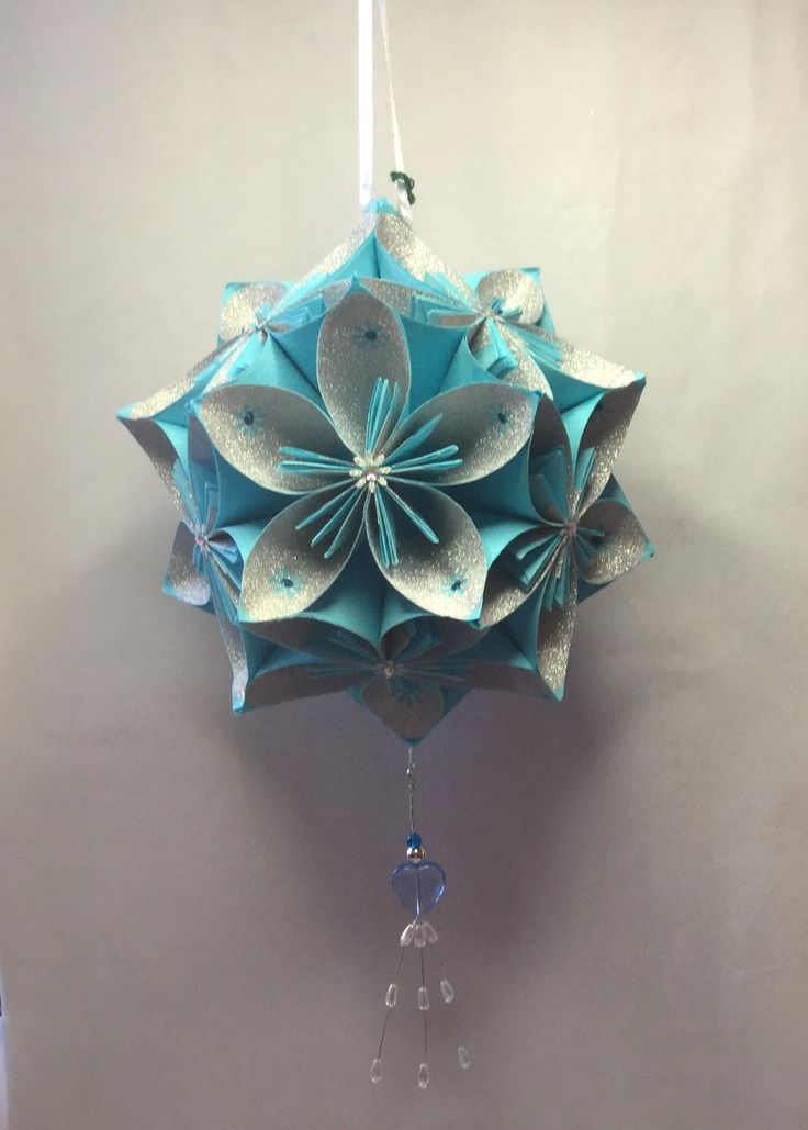 KO30  Light blue  with glitter inner petal...hanging beads...14cm sq.
