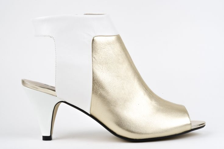 SS15 239 Wow your friends and turn headswith your edgy sense of style in these shoes by BELLINI. Naughty or nice? Wear with skinny black jeans for a rock'n'roll look or go for a white on metallic look that is sharp and sophisticated. If you love these shoes you'll know how to rock your own unique look in them - have fun! All leather uppers, inside zip, smooth fit around your ankle, small peep toe. HEEL: 6cm WIDTH: B-C