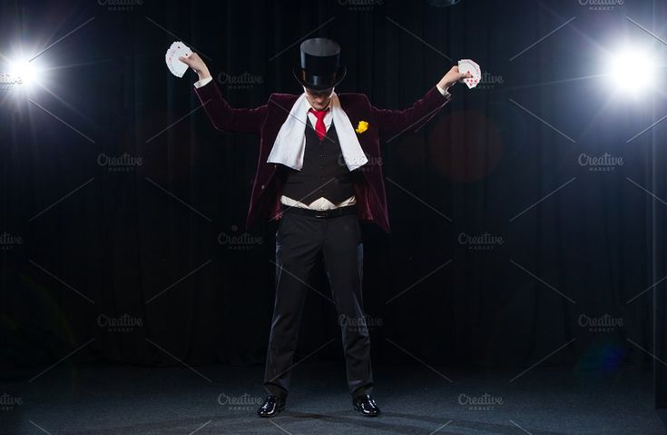 Midsection of magician showing fanned out cards against black background. Magician, Juggler man, Funny person, Black magic, Illusion Hands aside by mif on @creativemarket