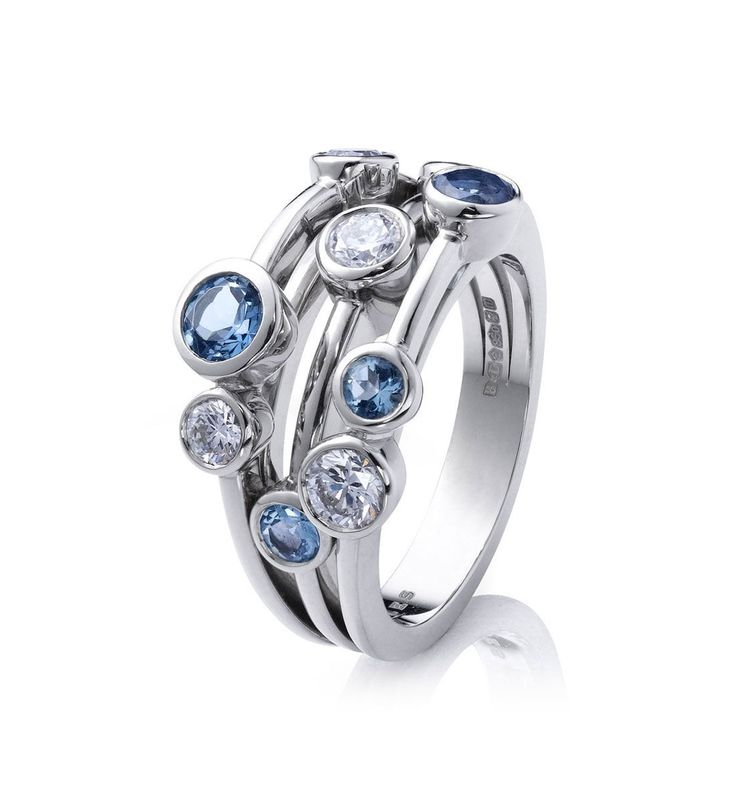 contemporary aquamarine and diamond ring from Boodles' Raindance collection ~ Set with 5 round brilliant cut aquamarines of 0.74ct and 4 round-brilliant cut diamonds of 0.63ct, in platinum