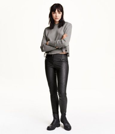 Low-rise leggings in stretchy imitation leather. Quilted details on knees, mock pockets with decorative zips, and visible zip at front.