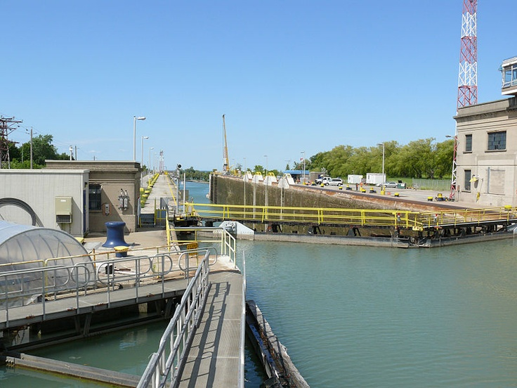 Thorold lock, The Welland Canal is a ship canal in Canada that extends 42 km (26 mi) from Port Weller, Ontario, on Lake Ontario, to Port Colborne, Ontario, on Lake Erie. As a part of the St. Lawrence Seaway, this canal enables ships to ascend and descend the Niagara Escarpment and to bypass Niagara Falls. Approximately 40,000,000 tonnes of cargo are carried through the Welland Canal annually by a traffic of about 3,000 ocean and Great Lakes vessels.
