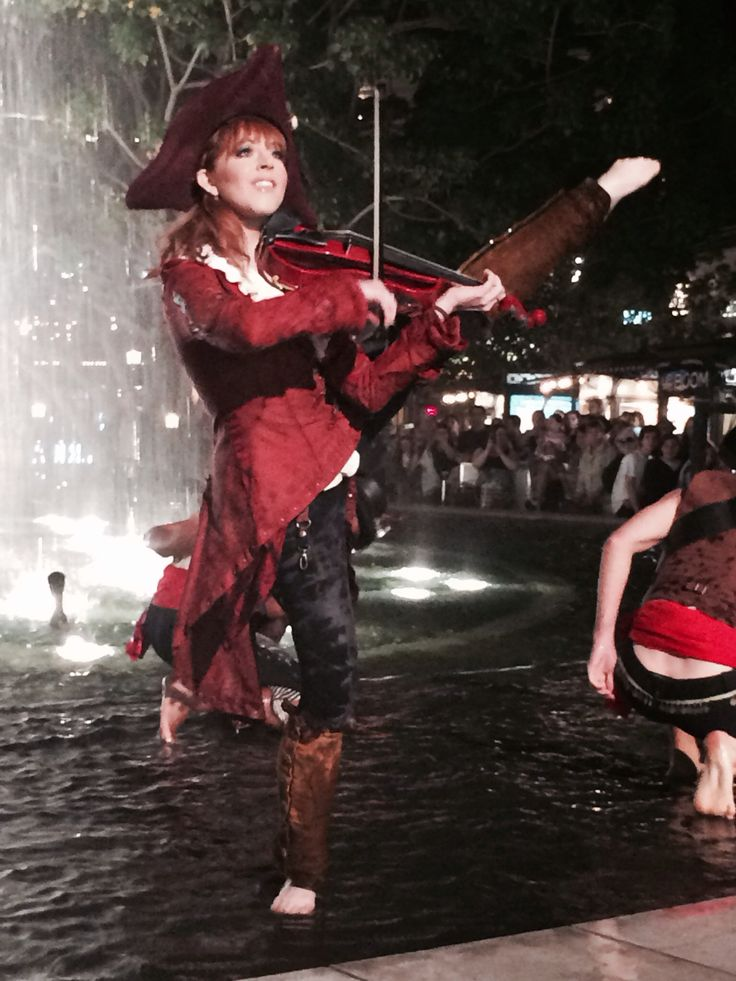 Lindsey Stirling Master of Tides video shot at the Americana in Glendale, California