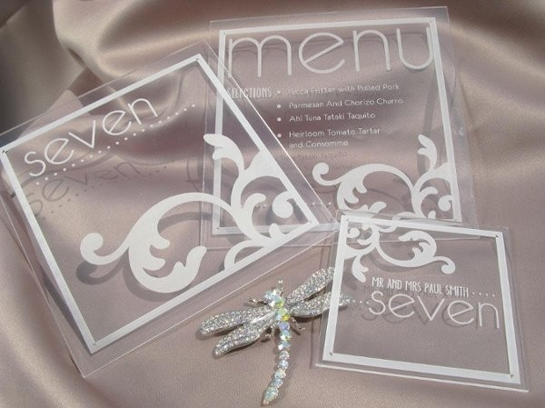 Plexiglass menu, escort cards, and table numbers By WEDology by Dejanae Events -- see more at LuxeFinds.com