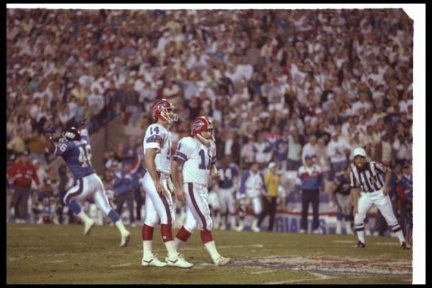 Scott Norwood looks dejected after missing a 47-yard FG wide right as time expired during Super Bowl XXV. (Getty)