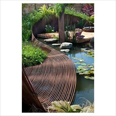 Curved fence:  Pond garden with centrepiece ribbon of woven rebar steel, deck area for sitting, wildflower meadow mat of native plants, green roof and wooden screen fencing - 'Reinforcing nature' at Gardening Scotland 2010: