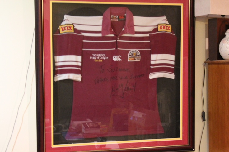 June 13 - Today's pic is ART. This is a piece of what I consider to be art that hangs on my wall. My personally signed Wally Lewis Queensland State of Original Jersey