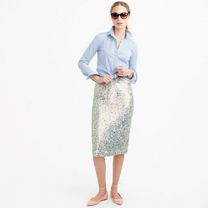 "We sewed three types of sequins (iridescent, frosted and clear) onto this fluid skirt to create an amazing shimmering effect whenever you walk. <ul><li>Sits at waist.</li><li>27"" long.</li><li>Falls below knee.</li><li>Poly.</li><li>Back zip.</li><li>Lined.</li><li>Dry clean.</li><li>Import.</li></ul>"
