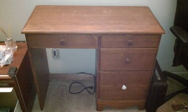 Convert old wood desk into bathroom vanity with above counter bowl-sink, hide plumbing behind drawers.