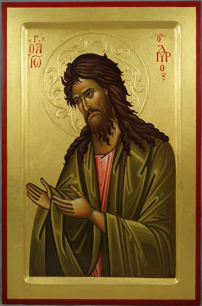 St John the Baptist - This is a premium quality icon made with pure 23K gold leaf. Painted using traditional technique - egg tempera, lime wood panel with oak support braces (slats) on the back, varnish, 23 karat gold leaf. The icon board features a raised border. About our icons Blessedmart offers hand-painted religious icons that follow