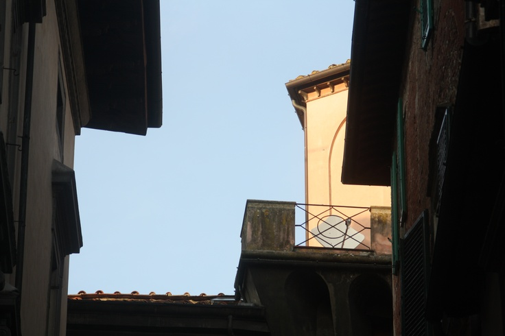 blue sky among ancient buildings in the heart of Lucca