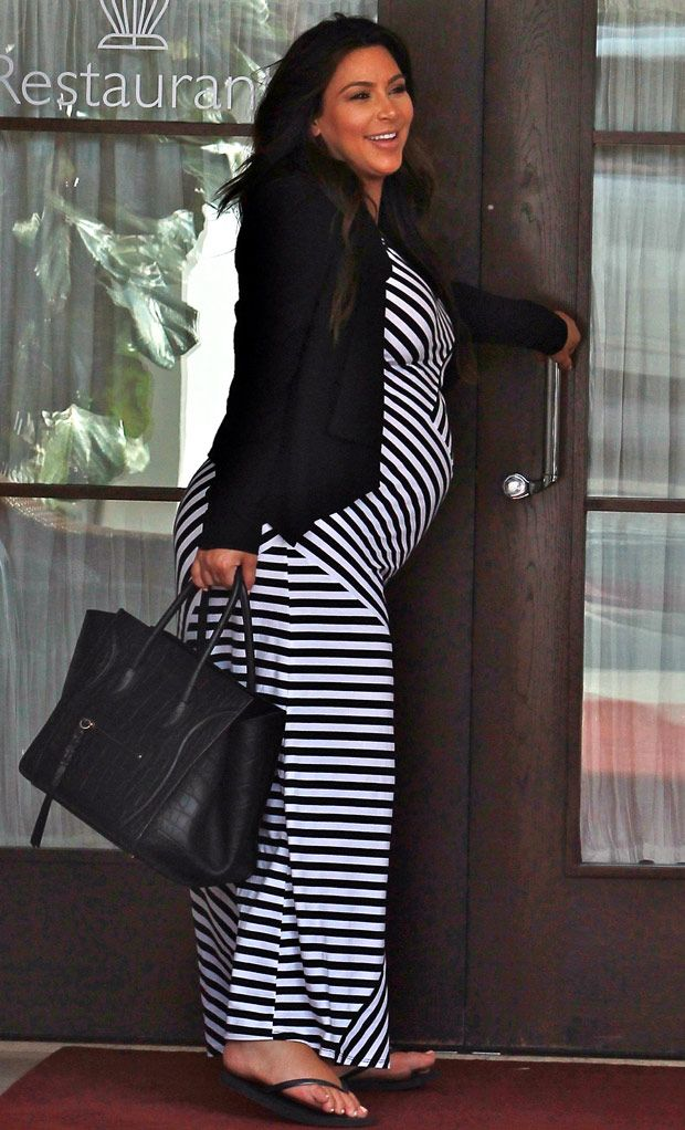 Pregnant Kim Kardashian who looks freshly sprayed tanned wearing a striped maxi dress and looking ready to pop, goes to Mr. C Restaurant in Beverly Hills eating with best friend Brittny Gastineau then stops at Ruth Chris for a second meal.