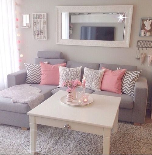 Loving the hints of pink. Adds a feminine touch to a neutral room.