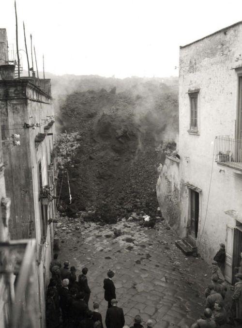 Lava Flow Engulfing a Village to the West of Vesuvius / 1944.