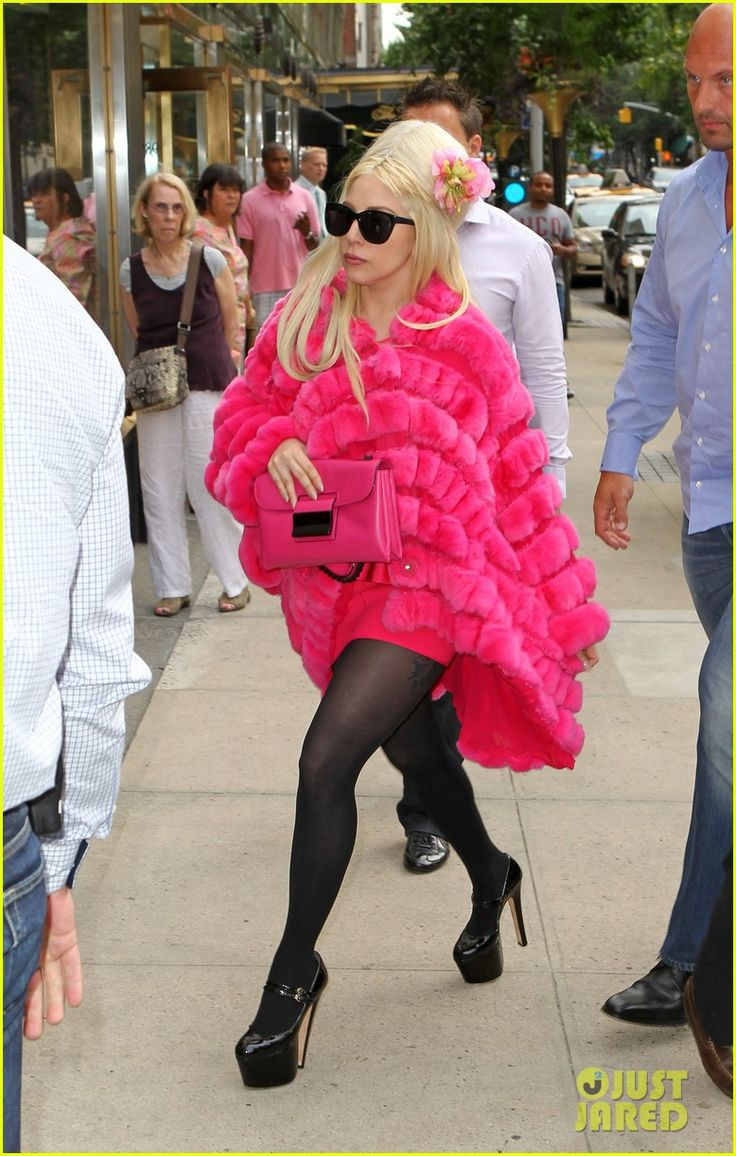 Afternoon shopping trip at New York's Giorgio Armani store where Gaga emerged rocking this bright pink fur from the designer's Autumn/Fall collection. August 8 2012.