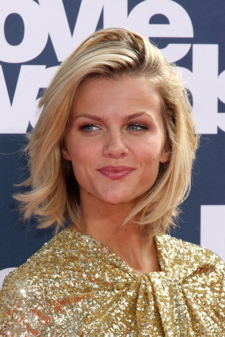 The model's golden-blond crop oozes California-girl cool. To get her look, ask your stylist for a choppy bob with graduated layers. Style an Easy Updo for Short Hair
