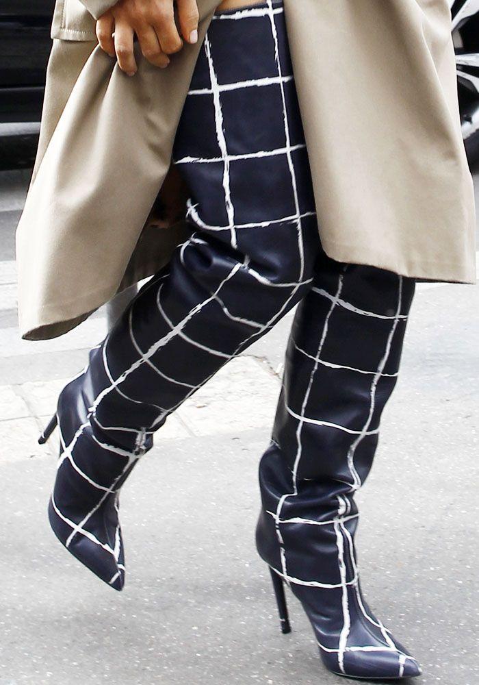 Kim stepped out in printed thigh high Balenciaga boots