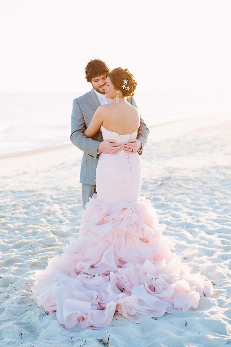 blush pink wedding dress on the beach