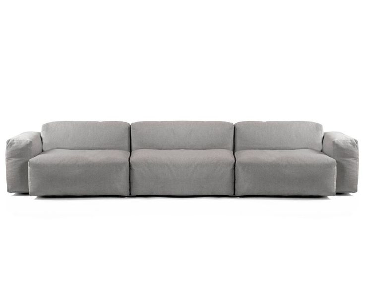 With all the traditional decoration and rich textiles and carpets, simple neutral grey sofas would work as a great background