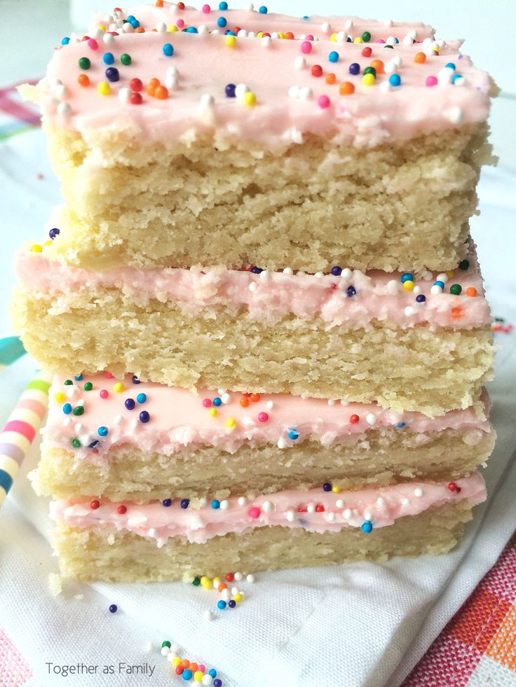 SUGAR COOKIE BARS | these are the softest, fluffiest, and yummiest sugar cookie bars ever! www.togetherasfamily.com