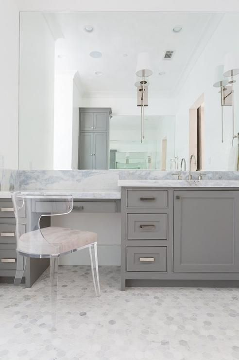 chic bathroom features a gray built in makeup vanity topped with gray and white marble