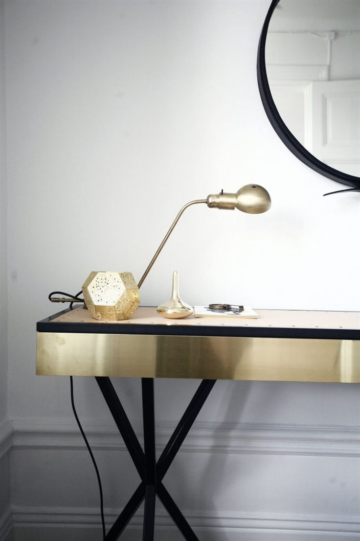 "Details of leather top: Sleek brass double-tripod console/desk from the ""No-Early Bird"" collection of Per Söderberg. As seen in the home of Christian Duivenvoorden."