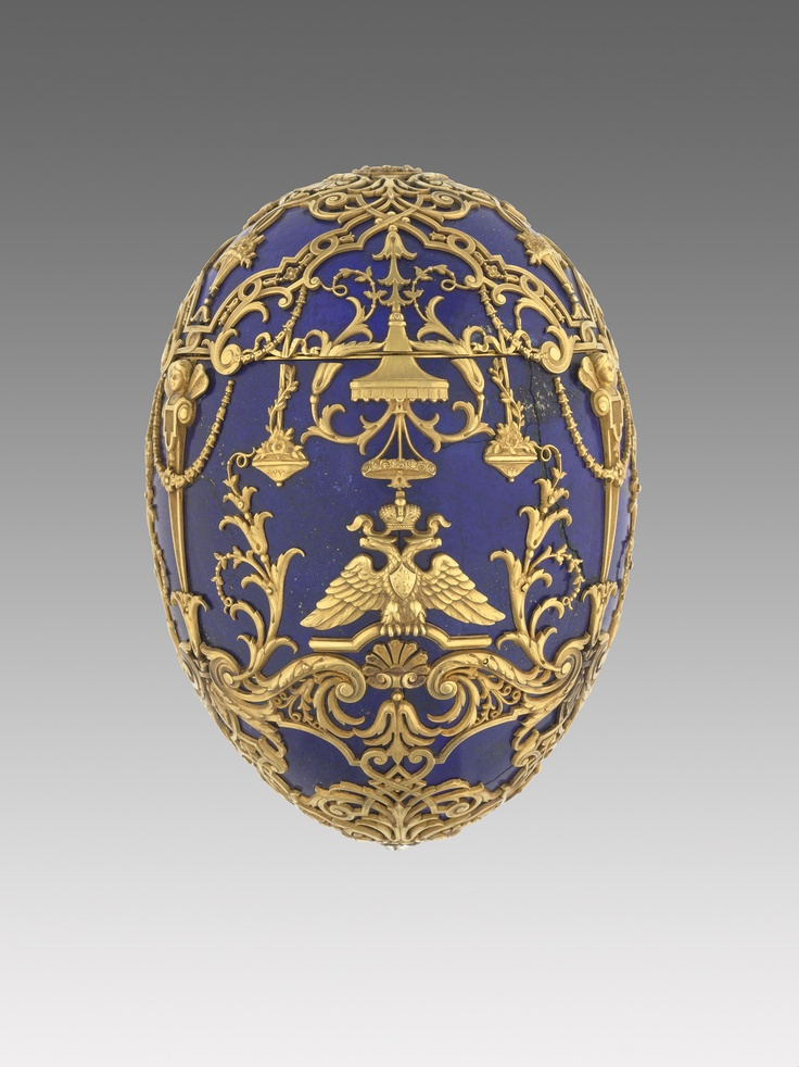 """Alexei, the long-awaited heir to the Romanov dynasty was born to Emperor Nicholas II and the Empress Alexandra Fedorovna in 1904. Unfortunately in 1911 the Heir-Tsarevich fell seriously ill, as he had inherited haemophilia from his mother via the line of Queen Victoria. The Emperor gave this egg to Alexandra to commemorate Alexei's recovery. The body and the cover of the Egg is formed from six segments of the finest lapis lazuli, embellished with gold cagework, eagles, hanging Chinoiserie…"
