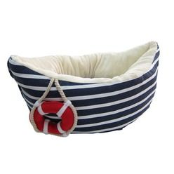 Bring a bit of seafaring style to your pet's sleeping arrangements with this nautical inspired Sailor Boat Bed. This quirky boat-shaped bed features a plush, padded cream interior for maximum luxury and comfort, with classic navy blue and white stripes on the exterior. A little decorative 'rescue rope' and red lifebuoy provide the finishing touches to this brilliantly fun bed, making it not only a comfy relaxation spot for your pet, but also an attractive addition to your home decor.