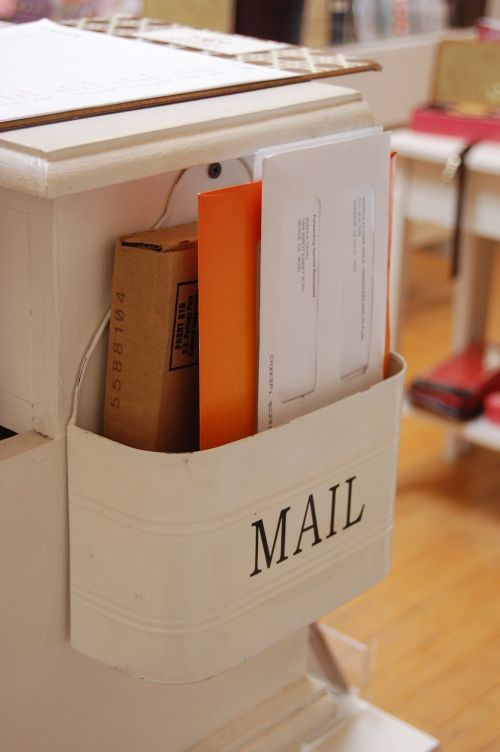 great way to keep your mail off the counter while you wait to sort it. I need to do this!