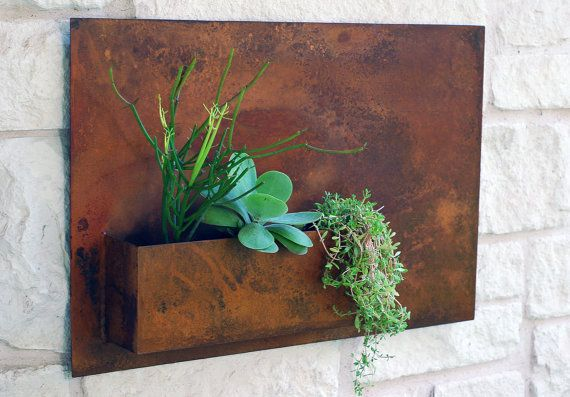 Welcome Home. This modern wall planter adds flair and style to vertical gardening, indoors and out. Have fun and install it in groups or let it make