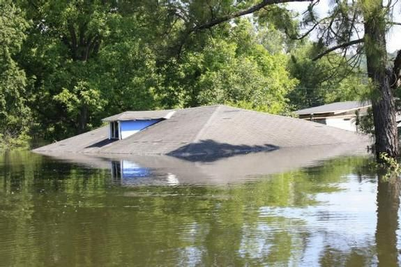 The only part of this home in Vicksburg Mississippi above water on May 13, 2011 was the roof.