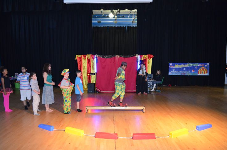 Tight rope walking circus during the show for their families at Cedar Mount Academy, Manchester.  MagicalCircus.co.uk