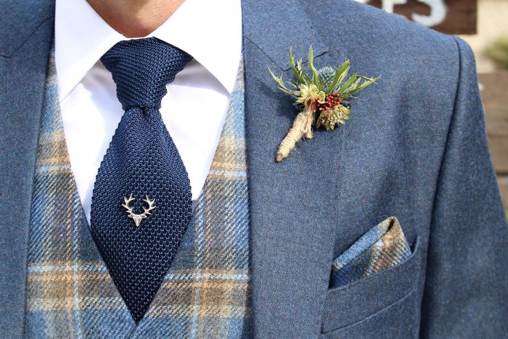 Scottish style groom - stag tie pin and tartan waistcoat at #upwalthambarns for an October wedding