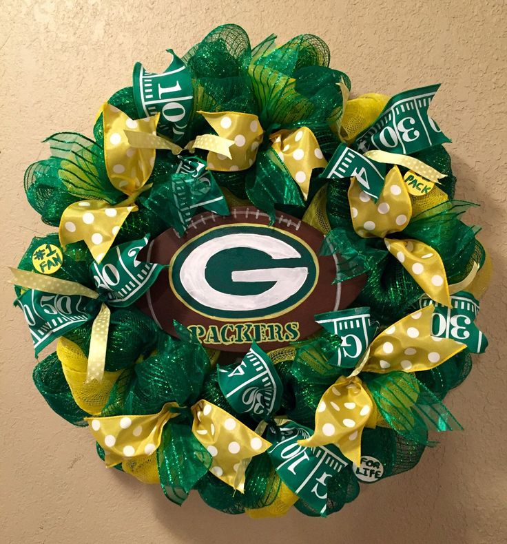 A personal favorite from my Etsy shop https://www.etsy.com/listing/252717424/green-bay-packers-wreath-green-bay
