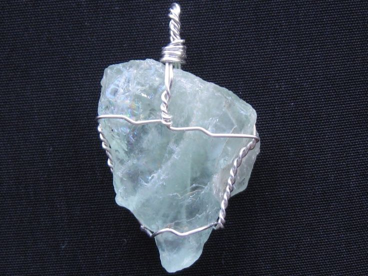 Raw aquamarine crystal pendant wire wrapped in sterling silver