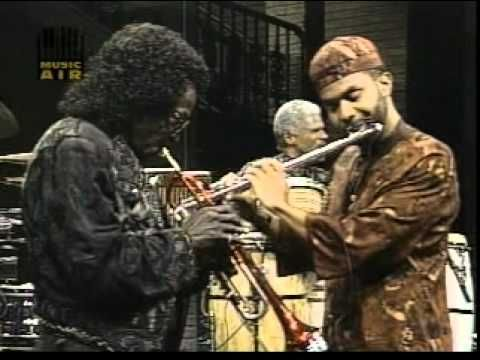 Miles Davis performs Jojo ( w/ Kenny Garrett on Alto sax and Foley on bass) on the Arsenio Hall Show on June 14th, 1989. Description from wn.com. I searched for this on bing.com/images