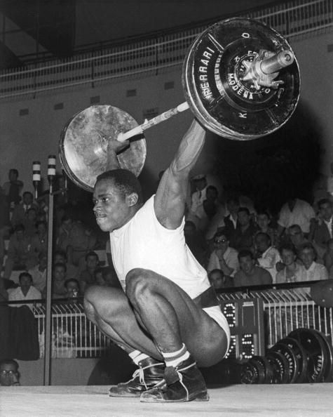 Team GB weightlifter Louis Martin competing in the Middle Heavyweight event at the Rome Olympics, 1960. Martin eventually won the bronze medal.