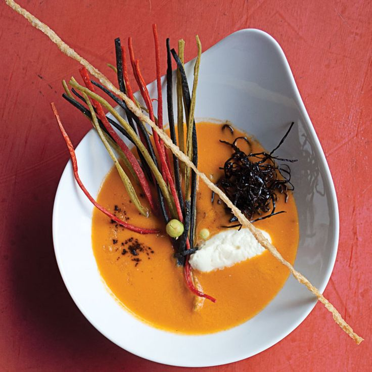 Sopa de Tortilla (Tortilla Soup) Recipe | This inventive take on tortilla soup from celebrated Mexican chef Martha Ortiz is garnished with silky goat cheese and crispy pork rinds. | SAVEUR