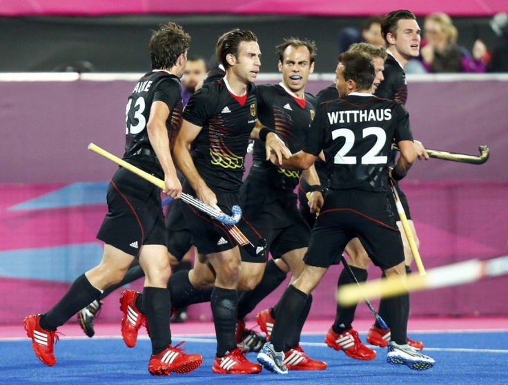 Germany's Zeller celebrates with his teammates after scoring a goal against South Korea during their men's Group B hockey match at the London 2012 Olympic Games at the Riverbank Arena on the Olympic Park