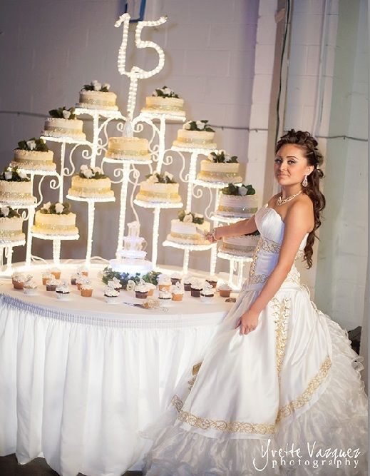 Gorgeous  Quinceañera cake stand and photo idea \\ Photo Credit: Yvette Vazquez Photography #Quinceanerareception # Quinceaneracake