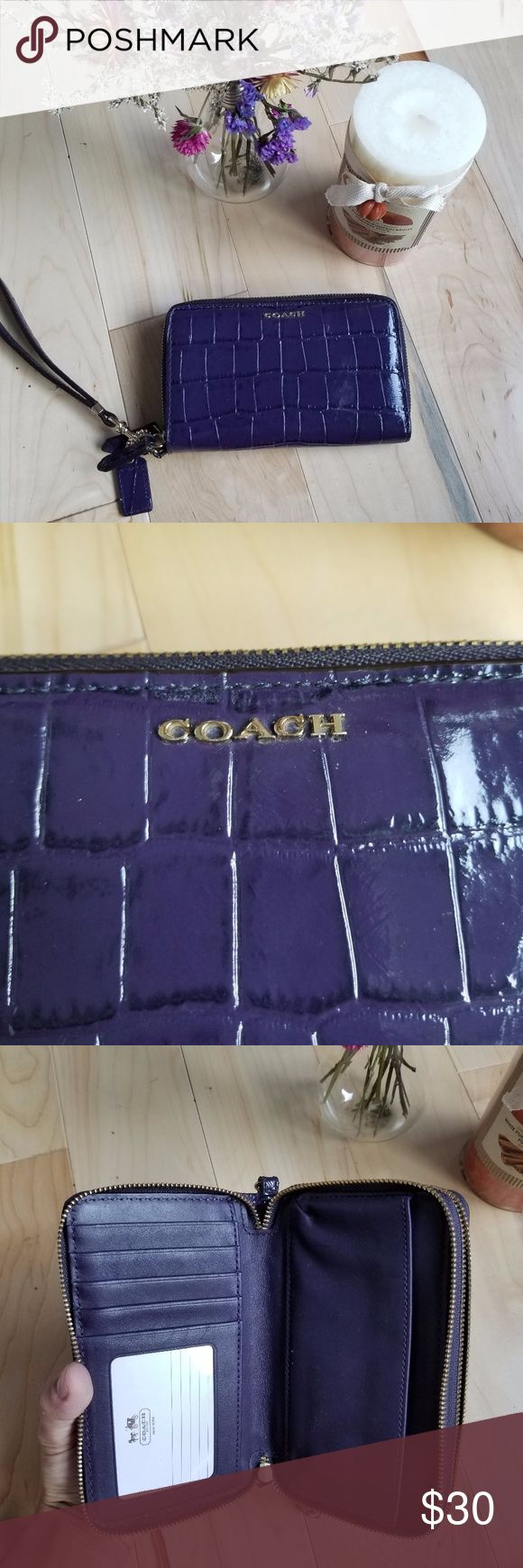Purple Coach Wallet Faux alligator leather Coach wallet,  easily fits an iPhone or Galaxy phone. Lots of space for cards & coins & things with 2 separate zipped areas. Looks brand new and has detachable wristlet keychain. Coach Bags Wallets