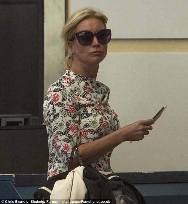 Glum: Denise Van Outen was decidedly down-beat when she was spotted at Barbados Airport on Wednesday