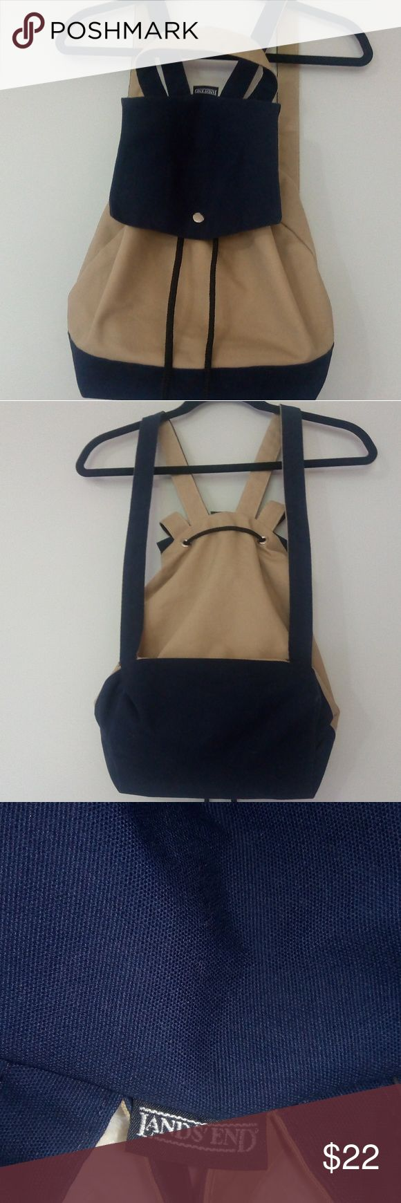 """Lands' End Backpack This is a medium sized fabric drawstring backpack with a silver press button closure from Lands' End. It is made in the USA and is in amazing condition. Straps: 25"""" long Width: 16.5"""" Length: 13"""" long Color: Navy and tan Lands' End Bags Backpacks"""