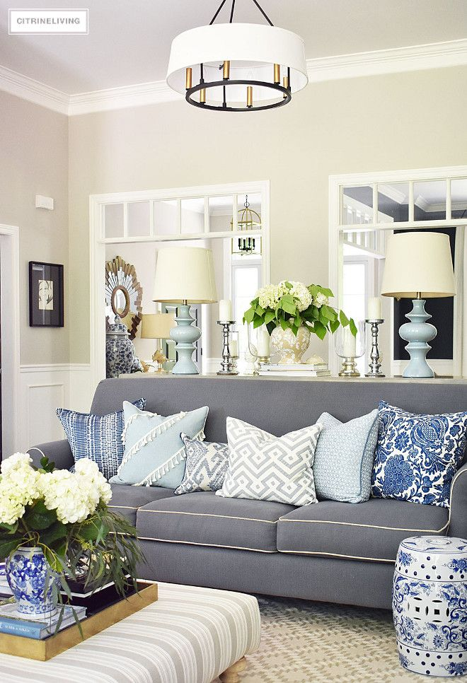 Grey Sofa With Blue And White Patterned Pillows Summer Decorated Living Room