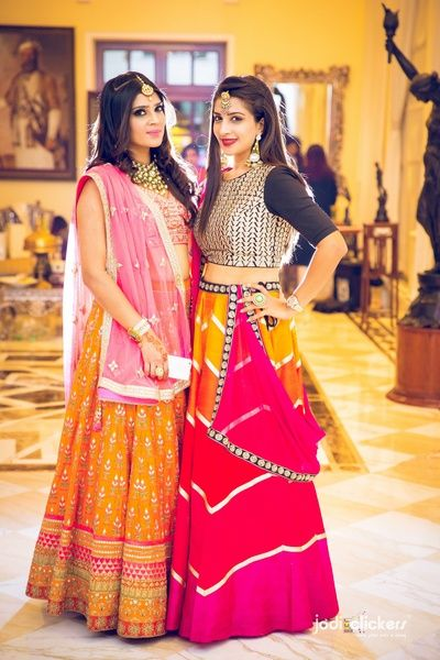 Sister of the Bride - Bride in a Yellow and Pink Lehenga, Sister of the Bride in a Yellow and Pink Paneled Lehenfa with Black and Silver Blouse | WedMeGood #wedmegood #sisterofthebride #lehengas #indianbride #indianwedding #bridal #sisterofthebrideoutfit #crop #top #mirrorwork