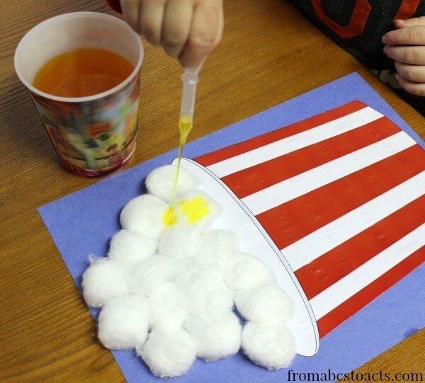 This super fun cotton ball popcorn bowl craft will help to refine your kids' fine motor skills!